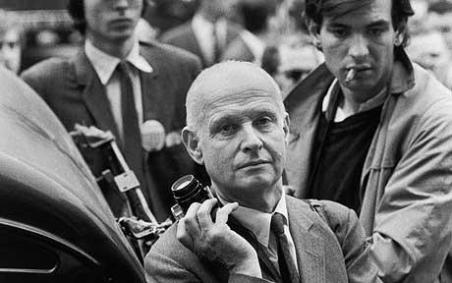 Henri Cartier-Bresson with his Leica